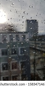 Picture taken of window looking out at the rainy and cloud weather outside