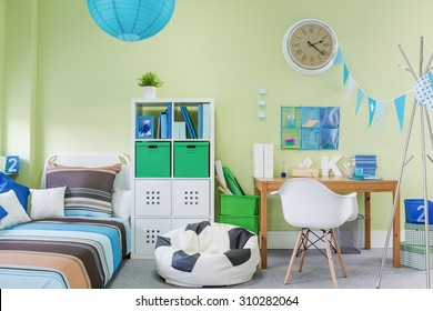 Picture of teenage boy room interior with stylish furniture