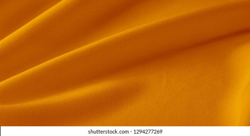 Picture Texture background yellow jaundiced xanthous silk fabric This medium/heavyweight faux silk fabric has a lovely sheen with slight color variations to give the appearance of slubs in the fabric