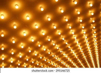 Picture of theater marquee lights in rows at an angle
