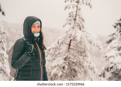 Picture of tourist woman walking in winter forest.