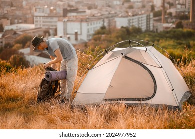 A picture of a toursit pitching the tent