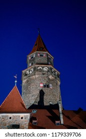 Picture of the tower of Bouzov castle at night.