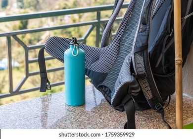 Picture of trecking bagpack and metal bottle for water. Travel, trecking, hiking concept. Stock photo