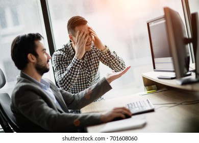 Picture of two businessmen having problems in office