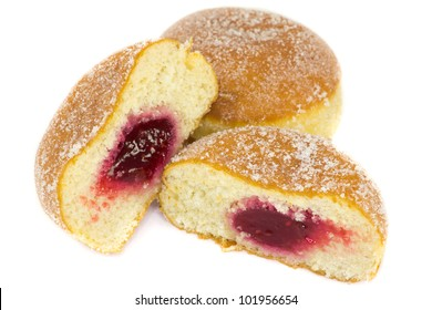 A picture of two jelly donuts where one is cutted in half, showing jelly