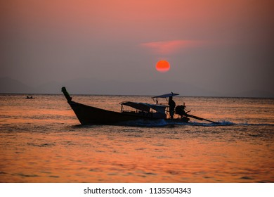 Picture of typical fisher man boat in sunset. Krabi. Thailand