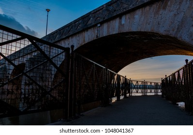 A picture from underneath the Cessart Bridge (Saumur) at sunset.