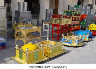 Picture of unique handmade barbecue pits and food warmers with retro style and lot of colors for sale in an arabic souk.