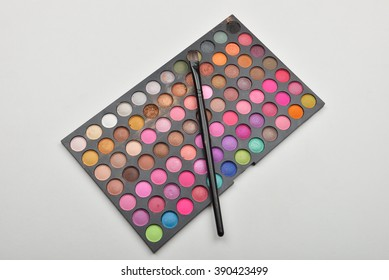 Picture of used professional makeup colorful eyeshadow palettes with brush on it.Care and beauty. Selective focus