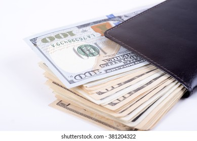picture wallet full of dollars on a white background