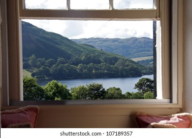 a picture window with a view onto Lake Ullswater and across to the Cumbrian hills