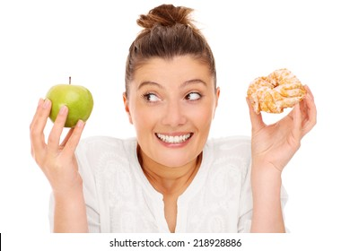 A picture of a woman choosing between apple and donut