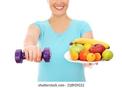 A picture of a woman with fruits and dumb-bells