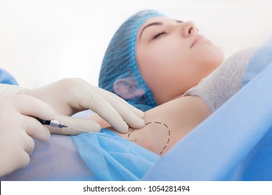 Picture of woman having anti sweat armpit mesotherapy in beauty salon