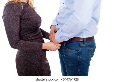 Picture of a woman having sexual gesture, opening a man's belt