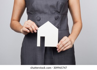 picture of woman holding paper house