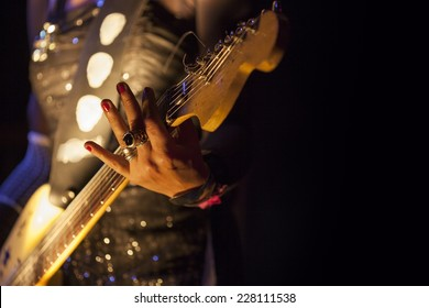 Picture of a woman playing electric guitar