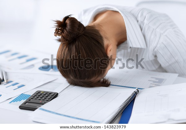 picture of woman sleeping at work in funny pose