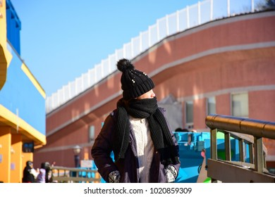 Picture of woman walk in very cold weather.