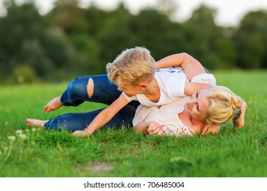 picture of a woman who romps with her son on the grass