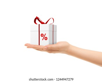 Picture of woman's hands holding a gift box with percent sign isolated on white