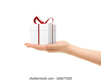 Picture of woman's hands holding a gift box isolated on white