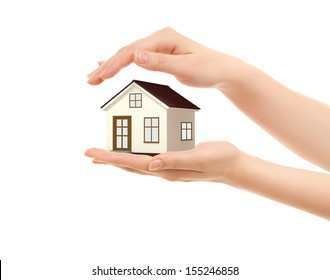 Picture of woman's hands holding a house isolated on white