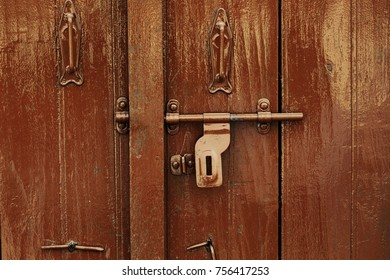 Picture of the wooden door with lock, background and texture, retro