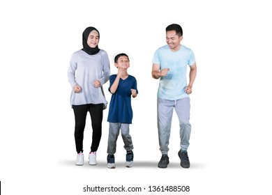 Picture of young Asian family looks happy while doing exercise run in the studio, isolated on white background