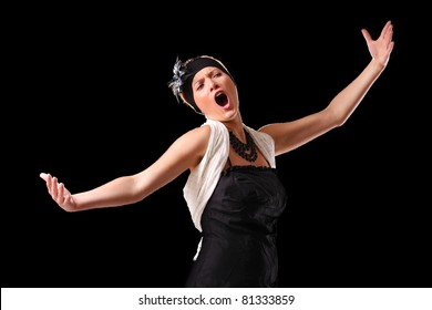 A picture of a young beautiful opera singer performing over black background