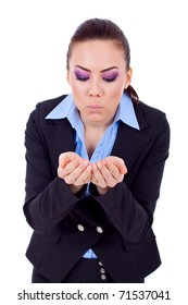 picture of a young business woman blowing something from her palms
