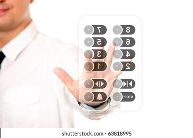A picture of a young businessman touching the elevator panel over white background