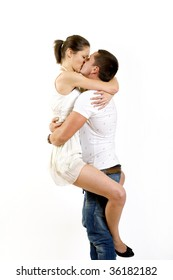 picture of a young couple kissing, man holding woman in the air