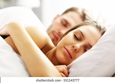 Picture of young couple sleeping in bed