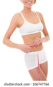 A picture of a young fit woman checking her measurements over white background