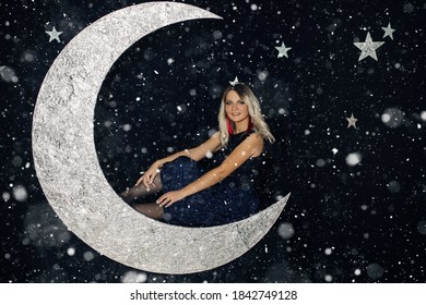 Picture of a young girl posing in the scenery of a big moon