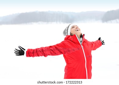 A picture of a young pretty woman having fun in the winter forest