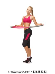 picture of young sporty woman with hula hoop
