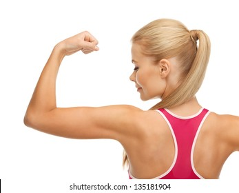 picture of young sporty woman showing her biceps