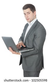 Picture of a young success businessman working on computer laptop over white background