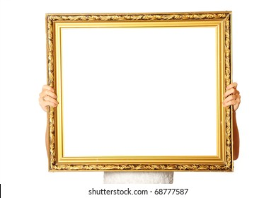 A picture of a young wife holding a golden frame over white background a lot of space for text