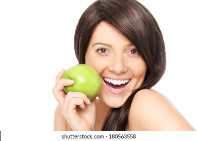 A picture of a young woman with a green apple posing over white background