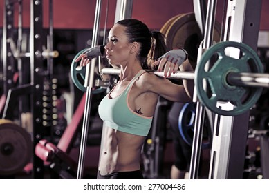 picture of young woman making exercise at the gym