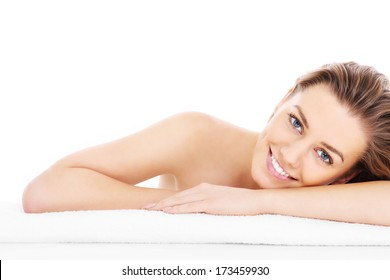 A picture of a young woman resting her head on a towel over white background