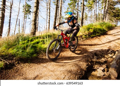 Picture of young woman riding mtb mountain bike, downhill