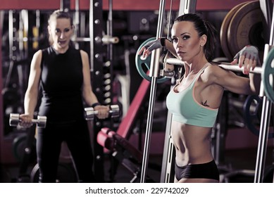 picture of young womans making exercise at the gym