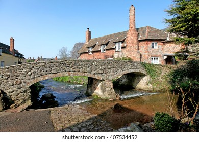 A picture-postcard English Village in northern Somerset in Springtime showing the ford, bridge, River Aller and cottages in the village.