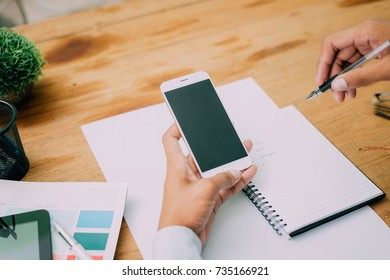 Pictures of businessman that operate on the table being checking data office desk background and writing note on wood table, Concept to checklist.