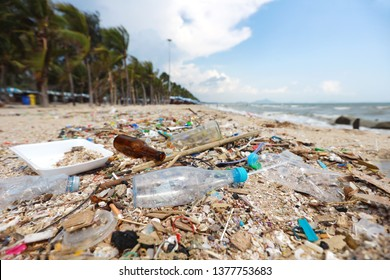 Pictures of dirty beach filled with plastic pollution, garbage and waste on sandy